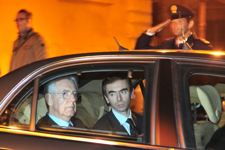 <p>Newly-named Italian Prime Minister Mario Monti (L) leaves the presidential palace on Nov. 13, 2011, after Italian President Giorgio Napolitano nominated him to form a new government.</p>