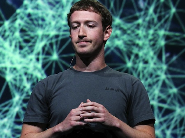 <p>Facebook CEO Mark Zuckerberg pauses as he delivers a keynote address during a Facebook f8 conference on September 22, 2011 in San Francisco, California.</p>