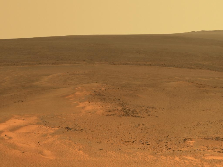 <p>This mosaic of images taken in mid-January 2012 shows the windswept vista northward (left) to northeastward (right) from the location where NASA's Mars Exploration Rover Opportunity is spending its fifth Martian winter, an outcrop informally named