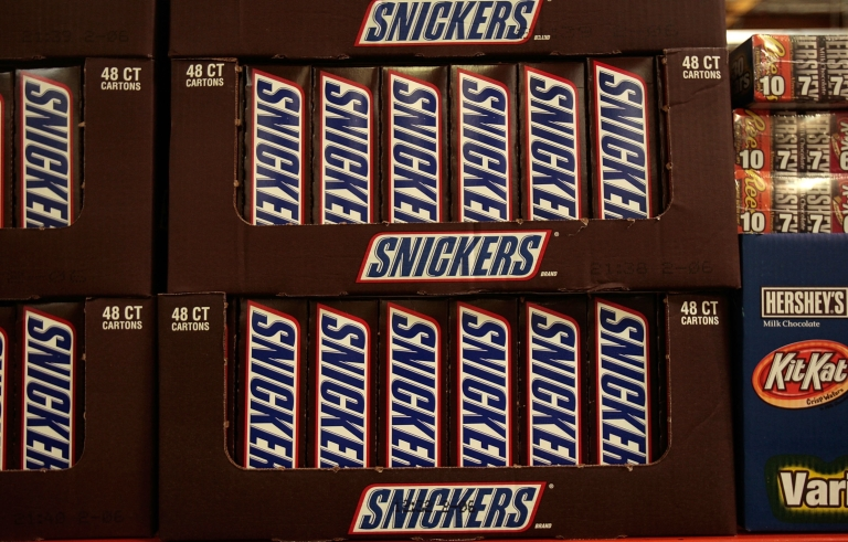 <p>A box of large Snickers candy bars at a Costco store in Tucson, Ariz., on April 4, 2008.</p>