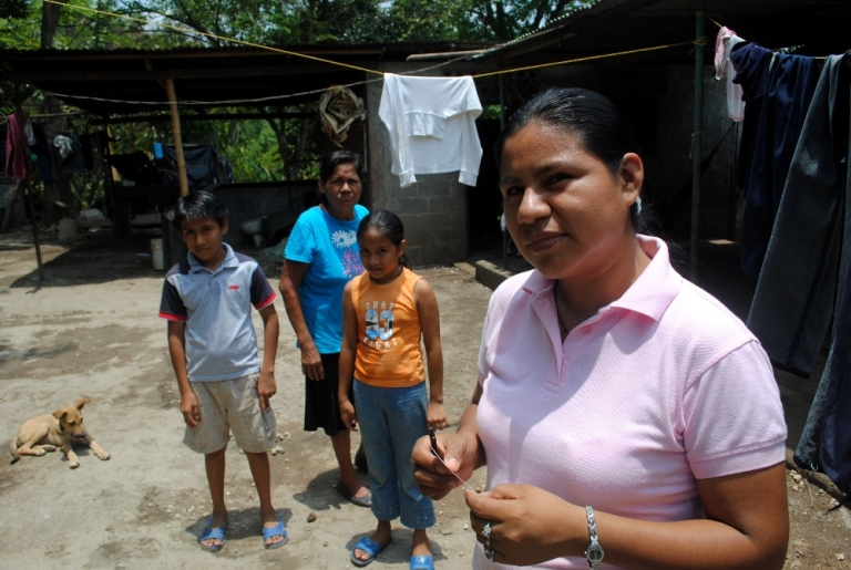 <p>Martha Acuña at home in Masaya, Nicaragua with her mother and two children. Her husband's death in a motorcycle accident left her as the only wage-earner in the eight-member household.</p>