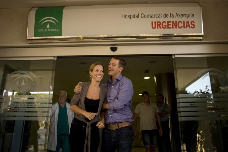 <p>Jantje and Fritz, daugther and son of Mary-Anne Goossens, who spent 18 days trapped at the bottom of a Spanish ravine, smile at the entrance of the hospital in Velez-Malaga on July 6, 2011, where their mother is staying for observation.</p>