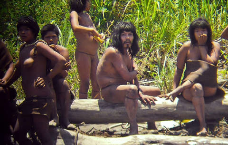 <p>Diego Cortijo used a zoom lens to photograph these members of the Masco-Piro tribe in Peru. According to Survival International, this is the closest they have ever been seen. Photo courtesy D.Cortijo/uncontactedtribes.org</p>