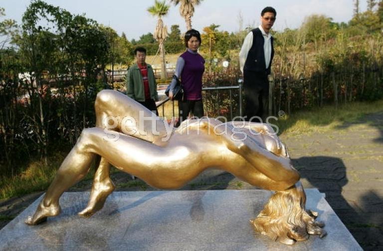 <p>A masturbating female statue at the