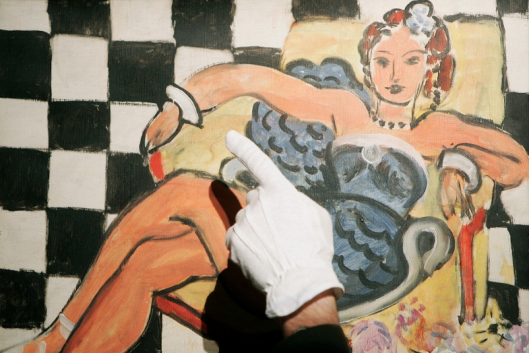 <p>'Danseuse Dans le Fauteuil, Sol en Damier, 1942' by Henri Matisse is displayed at Sotheby's Auction House on June 5, 2007 in London, England. The painting will be sold at auction along with masterpieces by Gerhard Richter and Francis Bacon.</p>
