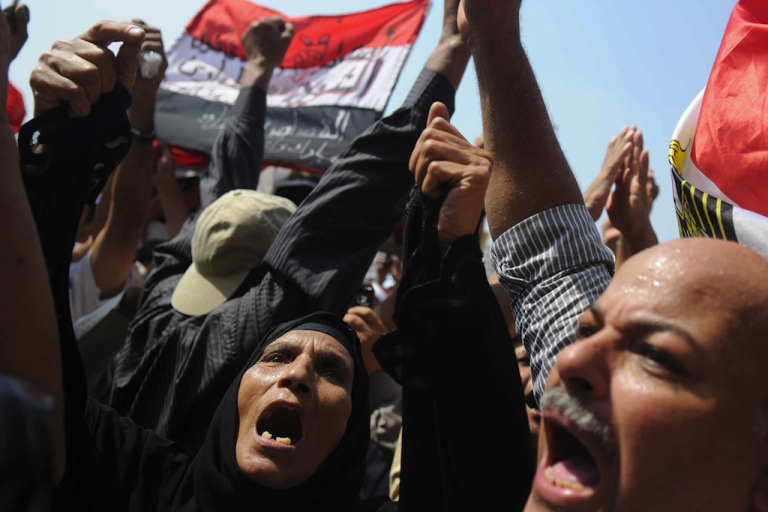 <p>Egyptian protesters shout slogans as they gather in Cairo's Tahrir Square last September during a mass rally to reclaim the revolution amid anger over the military rulers' handling of the transition. YouTube sensation, Matt Harding, was met with anger from protestors when he turned up in Tahrir Square on Sunday.</p>