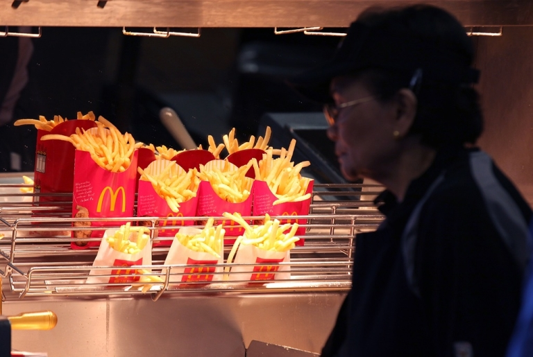 <p>McDonald's french fries sit under a heat lamp at a McDonald's restaurant on April 19, 2011, in San Francisco, California.</p>