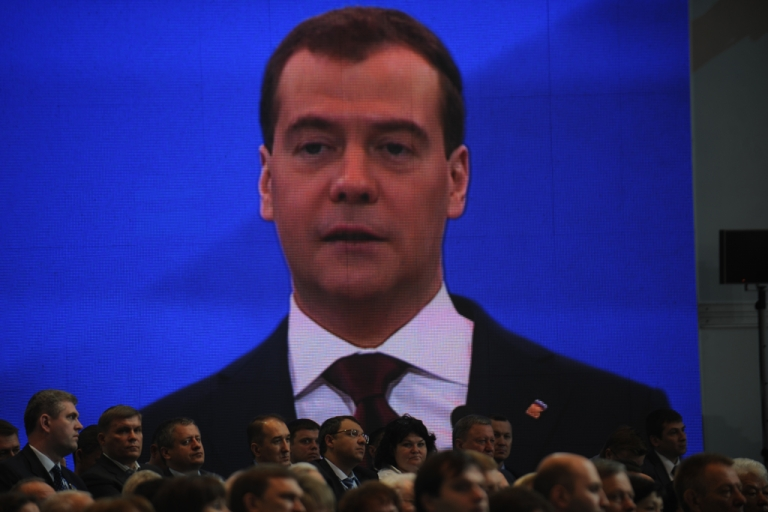 <p>Russian Prime Minister Dmitry Medvedev's speech is broadcast on a video screen during a United Russia congress in Moscow, May 26, 2012. United Russia confirmed Medvedev as its new chief in a bid to reverse flagging popularity that stoked opposition protests against the Kremlin.</p>