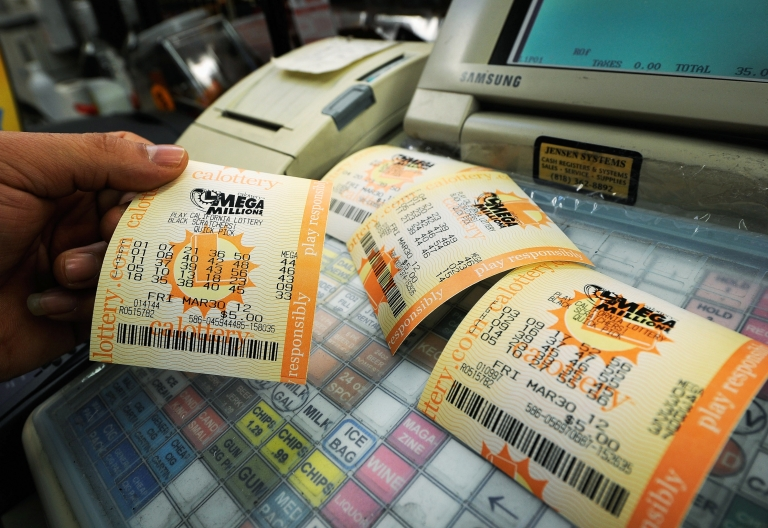 <p>Mega Millions lottery tickets at Liquorland in Covina, Calif., on Mar. 30, 2012.</p>