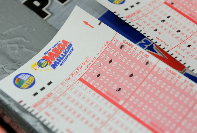 <p>Mega Millions lottery ticket forms at a convenience store on the east side of Manhattan March 30, 2012 in New York.Three winning tickets were sold for the $640 million jackpot - in Maryland, Illinois and Kansas.</p>