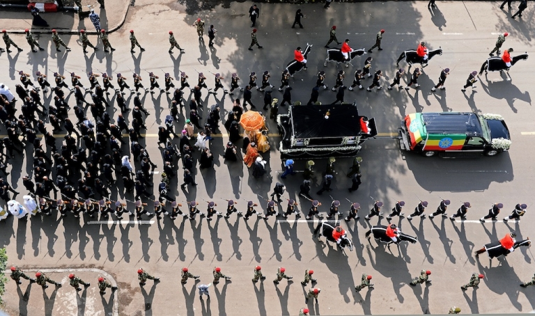 <p>A funeral procession transporting the coffin of Ethiopian Prime Minister Meles Zenawi makes its way through the streets of Addis Ababa on September 2, 2012. Meles Zenawi died on August 20, 2012. His funeral marks the end of a 21 year rule of the country.</p>
