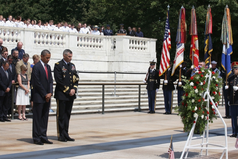 <p>President Barack Obama (L) stands during a moment of silence before placing a commemorative wreath during a ceremony on Memorial Day at the Tomb of the Unknowns at Arlington National Cemetery on May 28, 2012 in Arlington, Virginia. For Memorial Day President Obama is paying tribute to military veterans past and present who have served and sacrificed their lives for their country.</p>