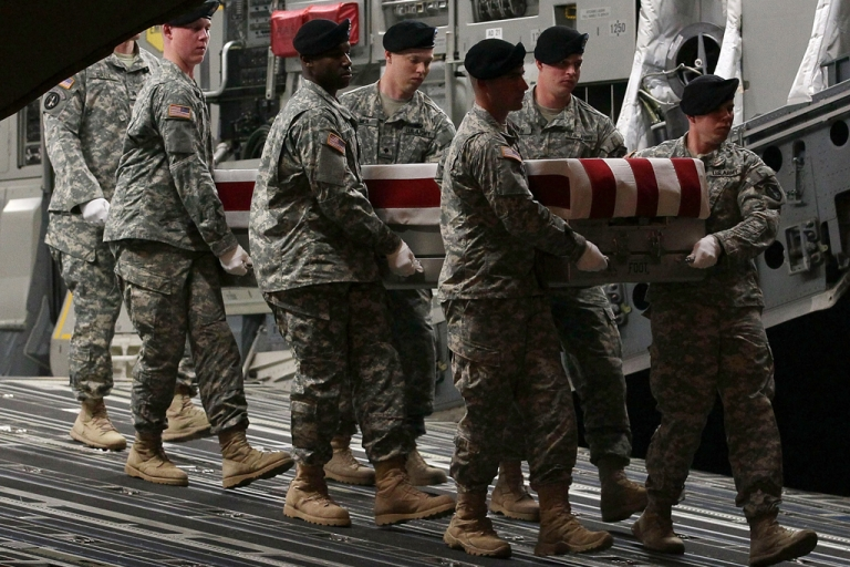 <p>A US Army carry team moves the transfer case of U.S. Army Sgt. Nicholas M. Dickhut during a dignified transfer at Dover Air Force Base, on May 2, 2012 in Dover, Delaware. Sgt. Dickhut, who was from Rochester, Minnesota, was killed during a firefight in southern Afghanistan's Kandahar province.</p>
