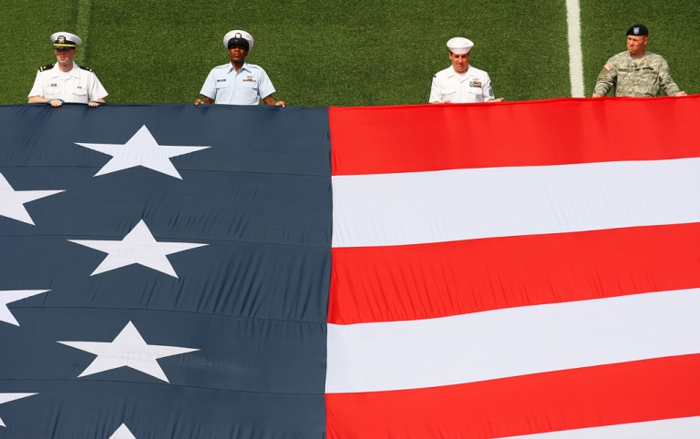 <p>Members of the Armed Forces unveil the flag to celebrate Memorial Day prior to the game between the Chicago Fire and the New York Red Bulls at Giants Stadium in the Meadowlands on May 24, 2009 in East Rutherford, New Jersey.</p>