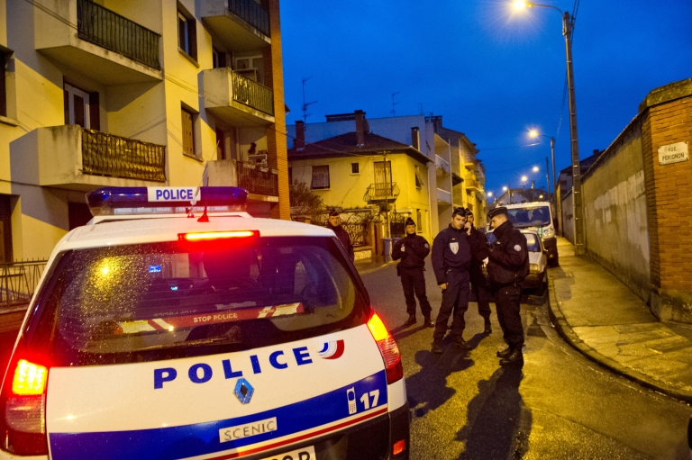 <p>Police surround a property during an operation to arrest 23-year-old Mohammed Merah, 23, the man suspected of killing seven victims including three children in separate gun attacks on March 21 in Toulouse, France</p>