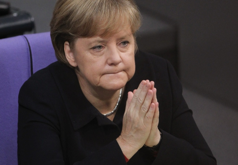 <p>Angela Merkel,German Chancellor, attends debates at the Bundestag after giving a government declaration on the Euro and the current Eurozone debt crisis on December 2, 2011 in Berlin, Germany.</p>