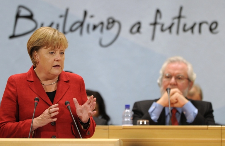 <p>German Chancellor Angela Merkel (L) addresses the 100th annual conference of the International Labor Organization (ILO) in front of the General-Director Juan Somavia at the United Nations Offices on June 14, 2011 in Geneva.</p>