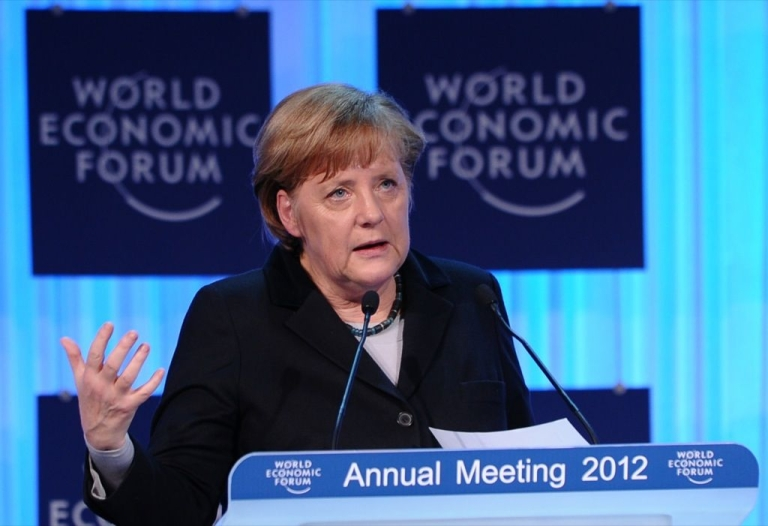 <p>German Chancellor Angela Merkel delivers a speech during the opening ceremony of the World Economic Forum (WEF), in the congress center of the Swiss resort of Davos on January 25, 2012.</p>