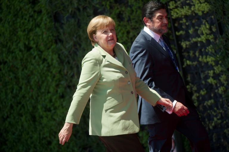<p>German chancellor Angela Merkel (L) arrives at the G20 Summit of Heads of State and Government in Los Cabos, Baja California, Mexico on June 18, 2012. The leaders of the world's most powerful economies are confronted by turmoil in the eurozone, a critical election in Greece and worsening bloodshed in Syria.</p>