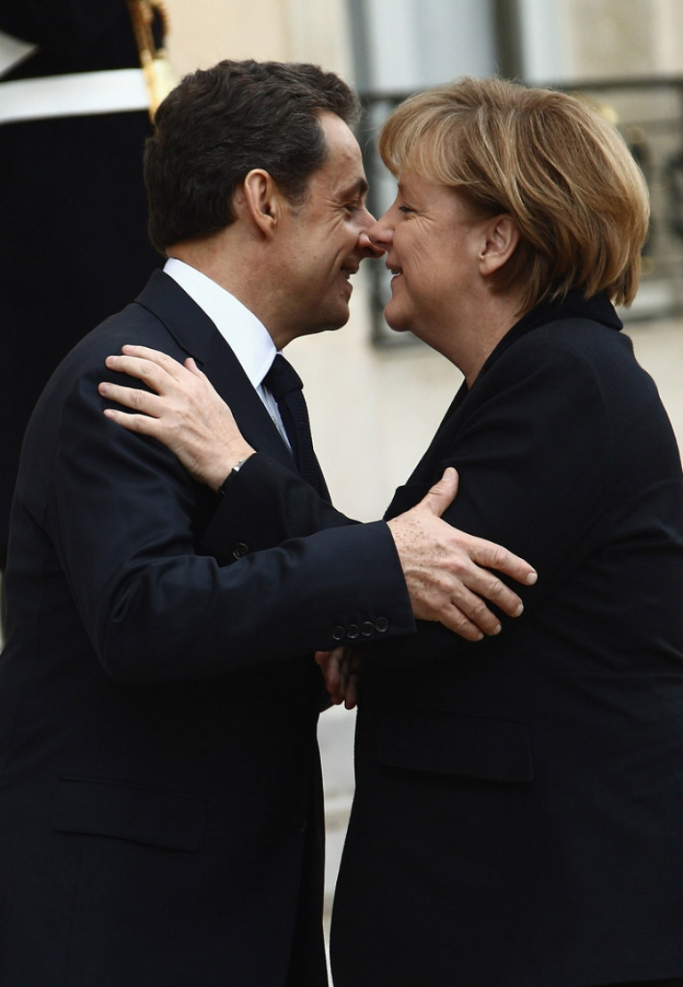 <p>French President Nicolas Sarkozy welcomes German Chancellor Angela Merkel at Elysee Palace on December. Merkel announced she will campaign for Sarkozy's reelection.</p>