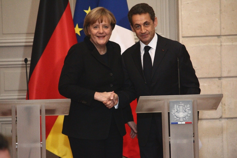 <p>Perfectly balanced pair - Chancellor Angela Merkel and President Nicolas Sarkozy agree to a rescue plan for the euro zone centered on balanced budgets.</p>