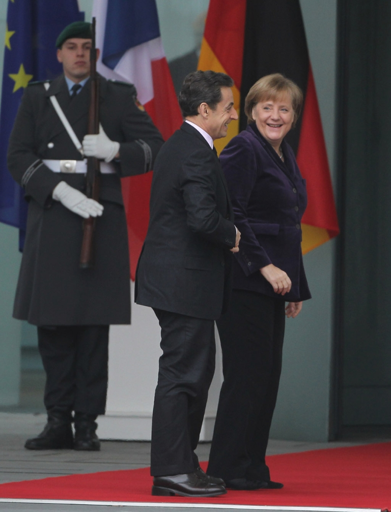 <p>So happy to see each other after the holidays: French President Nicolas Sarkozy and German Chancellor Angela Merkel in Berlin today, heading in to their latest meeting on how to save the euro</p>