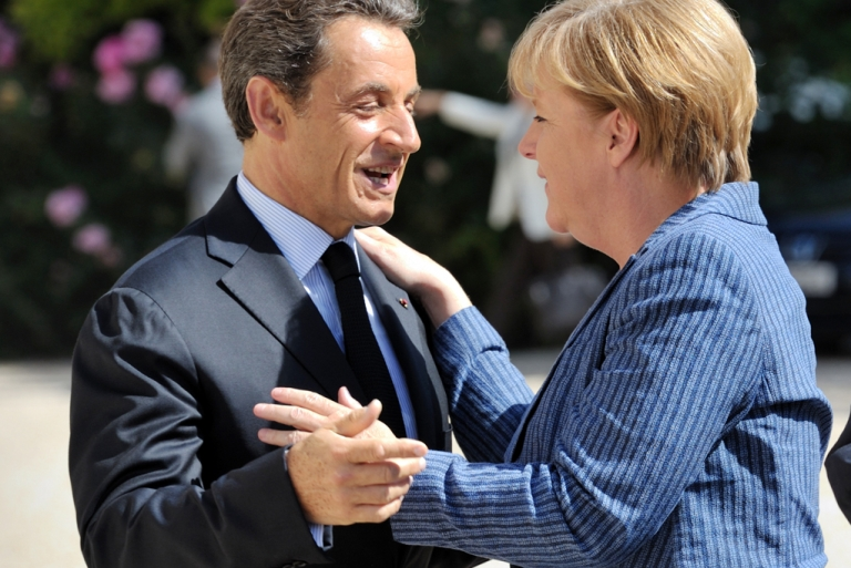 <p>France's President Nicolas Sarkozy welcomes German Chancellor Angela Merkel as she arrives for a meeting on debt crisis on August 16, 2011 at the Elysee presidential palace in Paris. Markets have been watching anxiously to see whether they would agree a plan to boost confidence and tame an unprecedented sovereign debt crisis.</p>