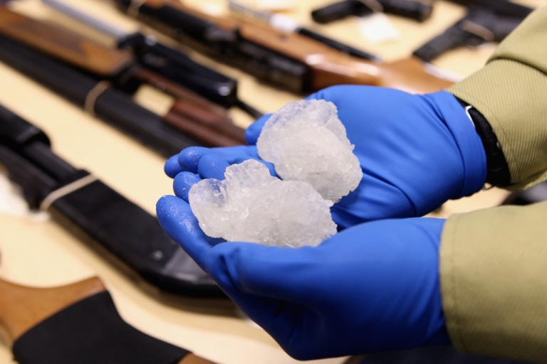 <p>Detective Inspector Greg Cramer points to a bag of crystal meth pills confiscated on August 19, 2010, in Auckland, New Zealand.</p>