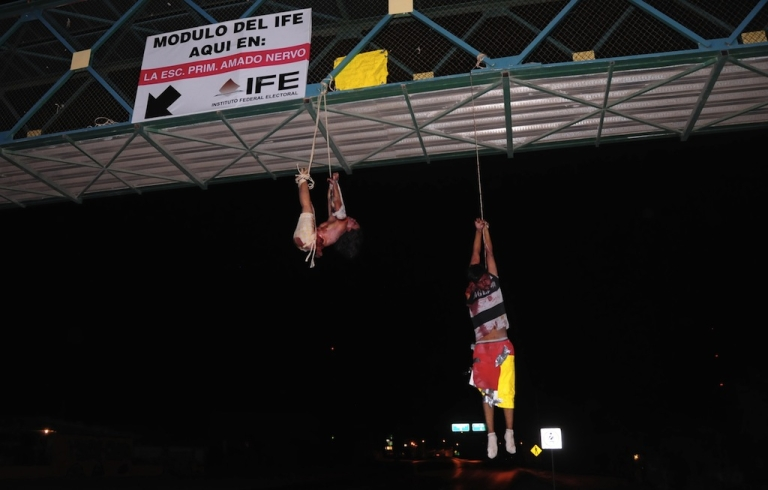<p>Two bloggers hanged from a bridge in Nuevo Laredo in September</p>