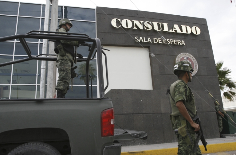 <p>Mexican soldiers guard one of the entrances of the United States consulate in Ciudad Juarez, Chihuahua state, Mexico on July 30, 2010. The United States closed its consulate in the Mexican border city of Ciudad Juarez to carry out a security review amid spiraling drug gang-related violence, including the fatal shootings in March 2010 of three people linked to the U.S. consulate in Ciudad Juarez, Mexico's notorious crime capital.</p>