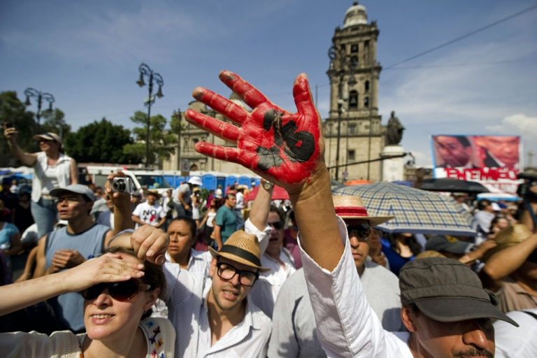 <p>Protesters during the last stage of a four-day silent march to protest against drug violence and the military strategy that has failed to stop it, at the Zocalo square, in Mexico City, on May 8, 2011.</p>