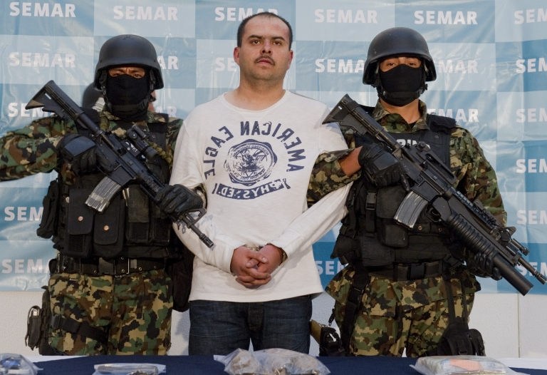<p>Sergio Antonio Mora Cortes, of the Zetas drug cartel and boss of Julian Zapata Espinoza, accused of the murder of US Immigration and Customs Enforcement agent Jaime Zapata, is presented to the press at the Mexican Navy headquarters in Mexico City, on Feb. 28, 2011.</p>