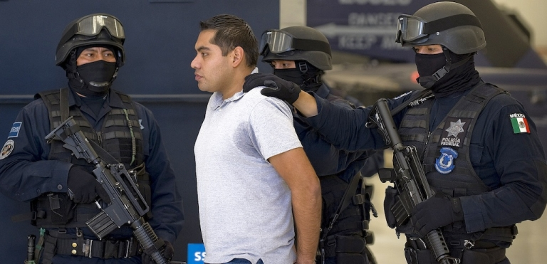 <p>Bogard Felipe Lugo is paraded before the media on July 15, 2012 in Mexico City.</p>