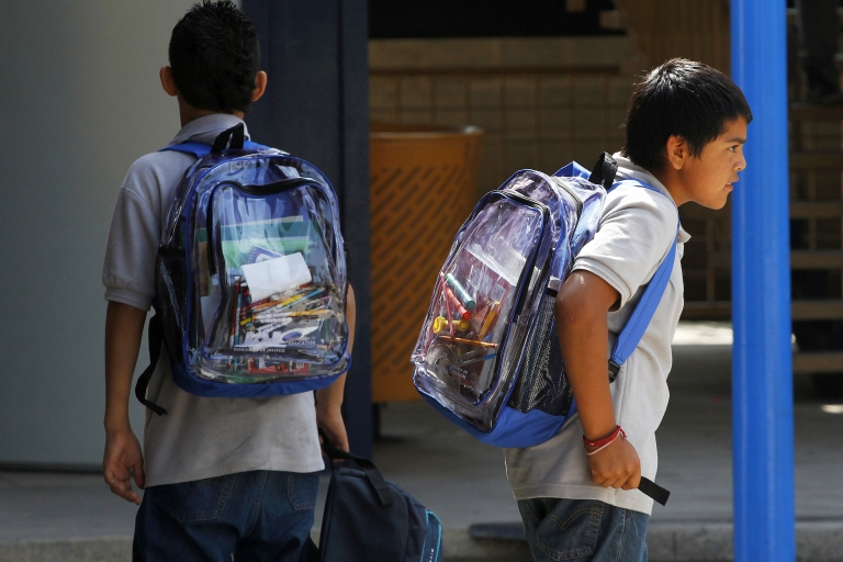 <p>High school students carry see-through backpacks in Guadalajara, Mexico, part of a recently introduced