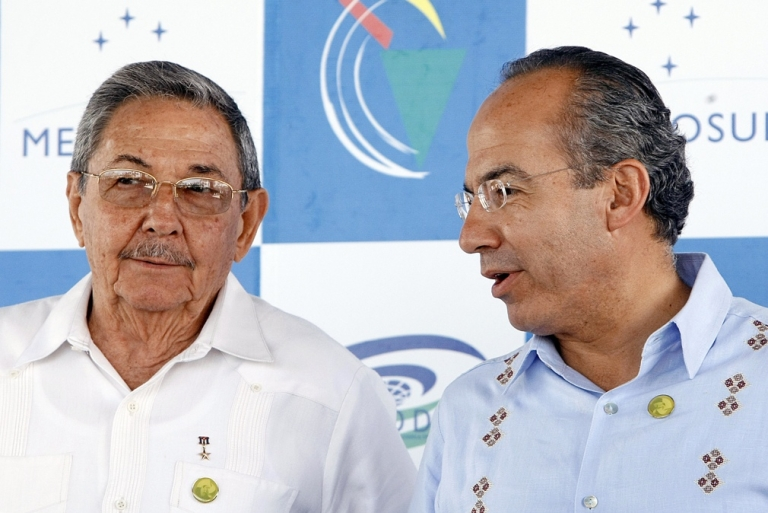 <p>Cuban President Raul Castro and Mexico's Felipe Calderon chat at a Latin American summit in Brazil in 2008. Calderon has promised to visit Cuba for years. Now's the time.</p>