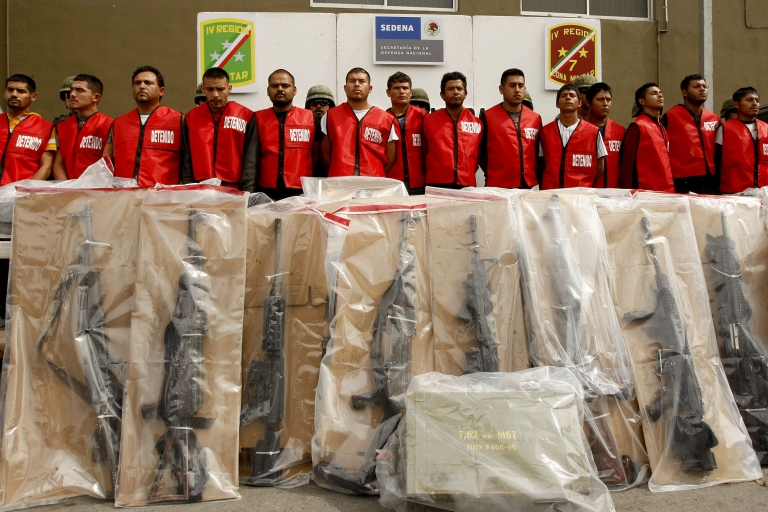 <p>Fourteen alleged members of the Zetas drug cartel and seized weapons are presented to the press in Monterrey, Mexico. Daniel Elizondo, also known as