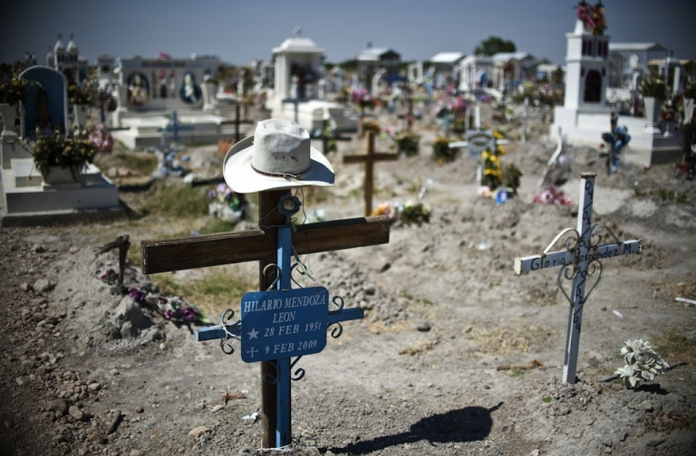 <p>This picture taken on May 16, 2011 shows a cemetery in Durango, the capital of the Mexican state of the same name, where bodies found in several mass graves were to be given a proper burial. Durango state sits on a key drug smuggling route to the United States and has been the scene of many drug-related murders in recent years.</p>