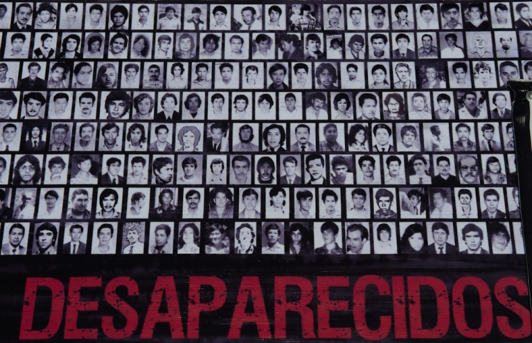 <p>Relatives and human rights activists show a banner with pictures of missing people while marching during a protest in commemoration of 'International Week of the Detained-Disappeared' on May 30, 2012 in Mexico City.</p>