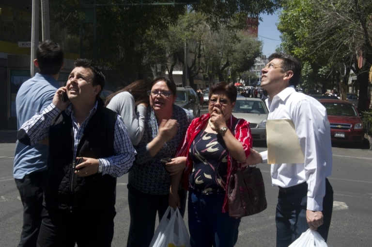 <p>People run to safety on the streets of Mexico City after a quake measuring 7.6 hits Mexico on March 20, 2012.</p>