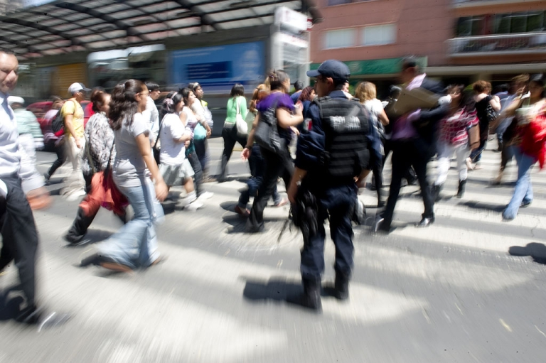 <p>A federal policeman stops the traffic to let people evacuating buildings to cross the street in Mexico City following a strong quake that hit Mexico on March 20, 2012.</p>