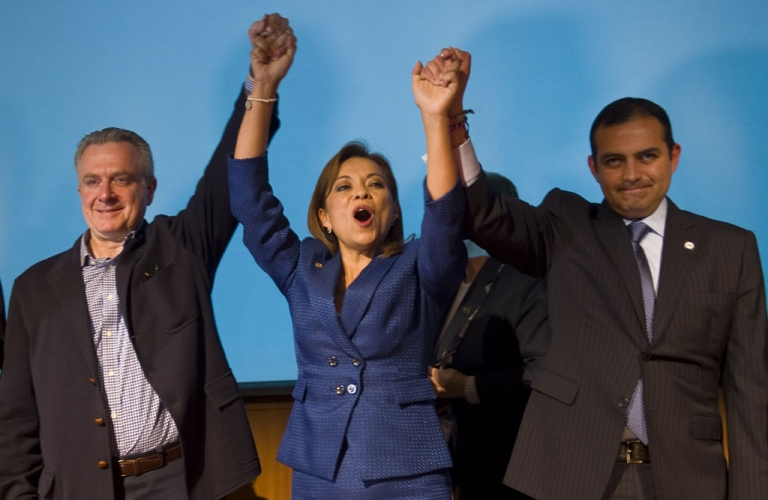 <p>Mexican presidential candidate Josefina Vazquez Mota (C) celebrates her victory with her counterparts Santiago Creel (L) and Ernesto Cordero (R) from National Action Party (PAN in Spanish) during a press conference in Mexico City on February 5, 2012. Mota is the official presidential candidate of the National Action Party.</p>