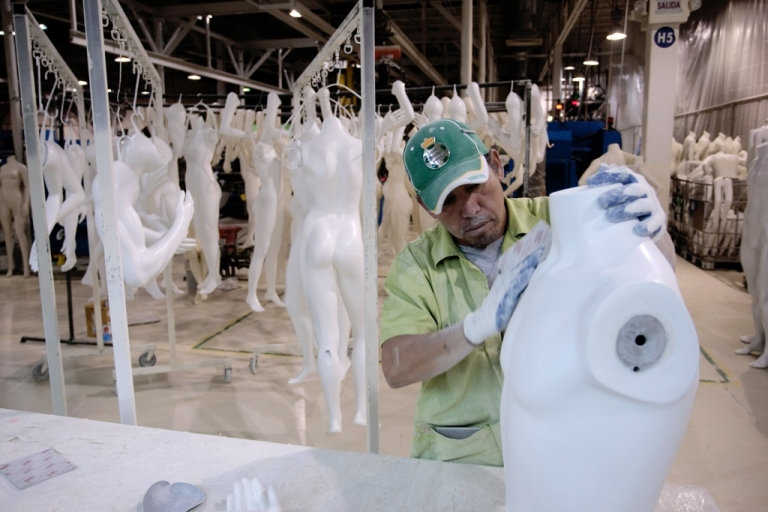 <p>A worker builds a mannequin in a factory in Ciudad Juarez. Drug war violence made Juarez a deadly city but multinationals are still booming there.</p>