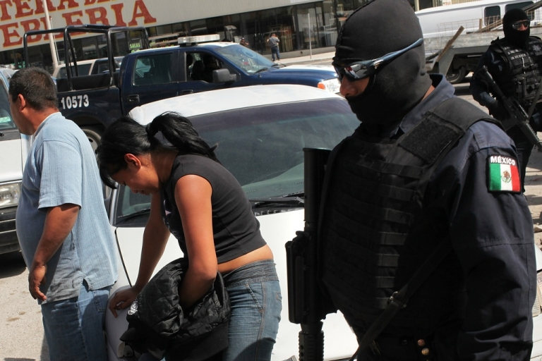 <p>Unsolved murders are all-too commonplace in Mexico these days. Here, people mourn loved ones in Juarez.</p>