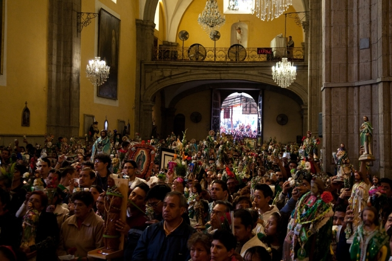 <p>San Judas, or St Jude, draws huge crowds bearing statues and images of their patron once a month in Mexico City.</p>