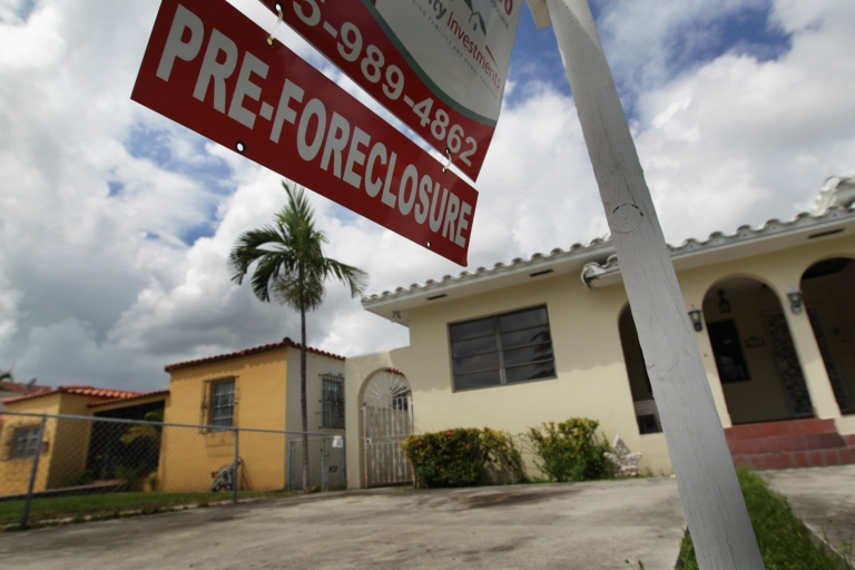 <p>A pre-foreclosure sign in front of a home in Miami on Sept. 16, 2010.</p>