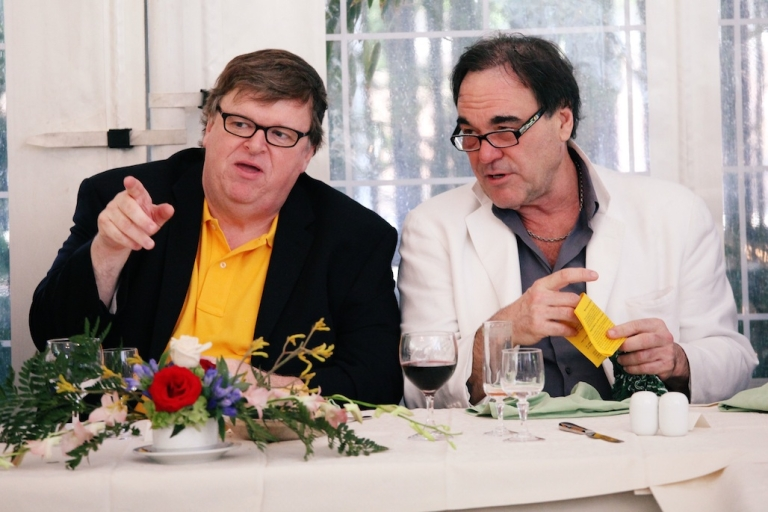 <p>This September 6, 2009 photo sows directors Michael Moore and Oliver Stone attending a lunch at the Quatro Fontani Hotel during the 66th Venice Film Festival.</p>