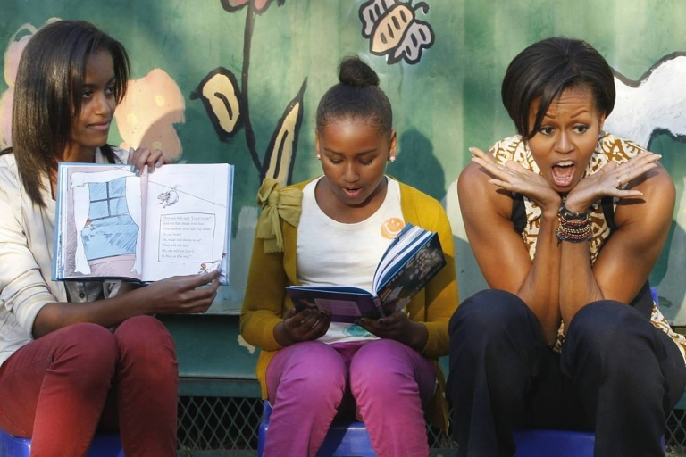 <p>Michelle Obama entertains children while she takes turns with daughters Sasha, left, and Malia by reading