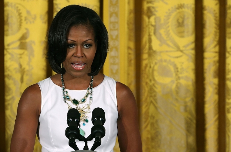 <p>First lady Michelle Obama speaks during a luncheon in the East Room of the White House, on July 13, 2012 in Washington, DC. The First Lady on Feb 9 attended the funeral of 15-year-old Hadiya Pendleton, murdered in a gang-violence incident in Chicago in January.</p>