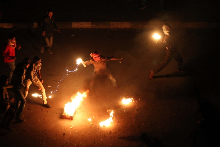 <p>Egyptian demonstrators demanding the ouster of President Hosni Mubarak throw fire bombs at police in Suez on January 27, 2011.</p>