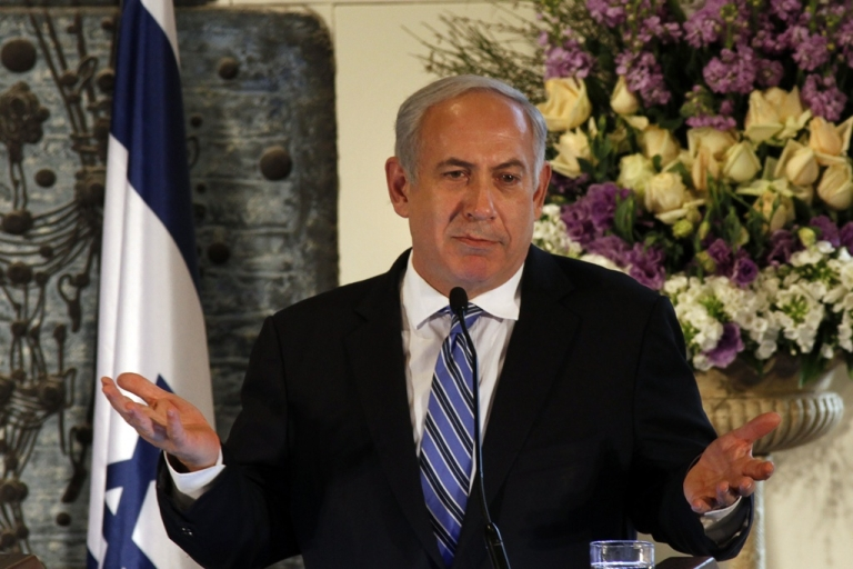 <p>Israeli Prime Minister Benjamin Netanyahu gestures as he speaks during the swearing in ceremony of Israel's Supreme Court President, Judge Asher Grunis on Feb. 28, 2012 in Jerusalem.</p>
